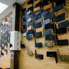 Multiple lecture theatre desks used for the wall display in the Physiology building at UQ St Lucia.