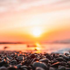 Sunrise over a pebbled beach