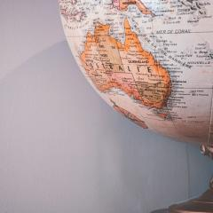 Image of a globe, with Australia in the bottom left corner