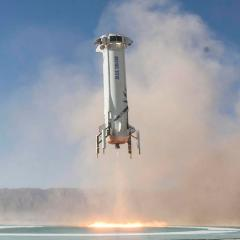 An image of the New Shepard booster landing.