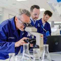An image of UQ COVID-19 vaccine project co-leader Professor Paul Young, project director Professor Trent Munro, and project co-leader Associate Professor Keith Chappell in the lab.