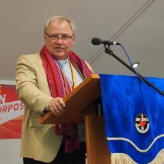 An image of Reverend David Baker delivering a sermon