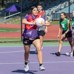 An image of a Diamond Spirit camp participant playing a game of netball at UQ's St Lucia campus.