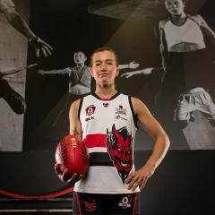 An image of UQ student and QAFLW player Jamie Howell