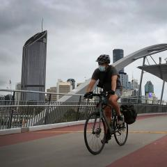 A man rides to work in the Brisbane CBD.