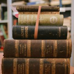An image of a stack of old books