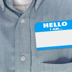 An image of man wearing a name tag