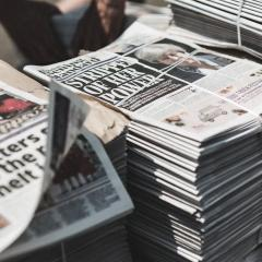 An image of a pile of newspapers