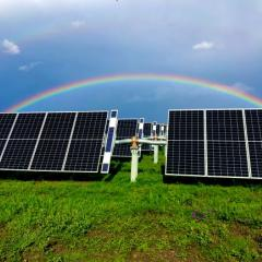UQ solar farm with rainbow